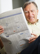 Senior man reading stock listings