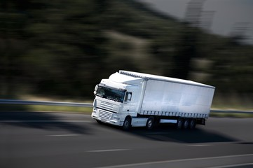 speed semi-truck on highway