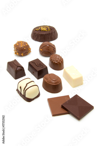 tasty chocolate bonbons over white background