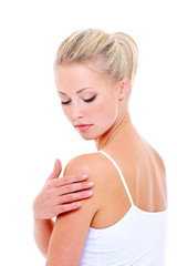 Woman care massaging her shoulder