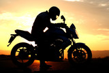 Fototapety motorcyclist silhouette at the sunset