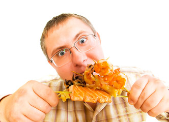 Man Eating an  Japanese Food .