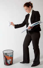 business woman deleting papers