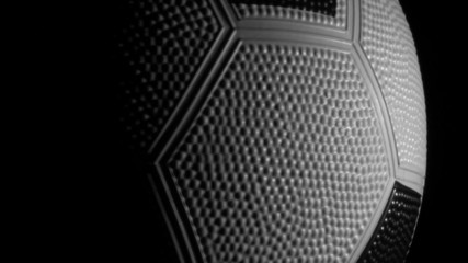 Soccer ball rotates against black - HD