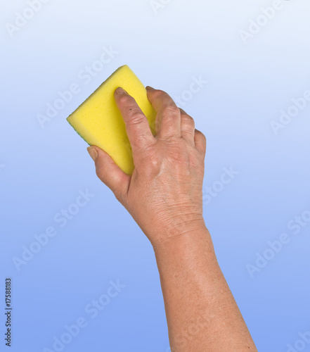 Hand with sponge isolated on blue background