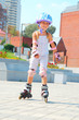 child on inline rollerblade skates