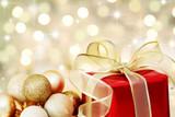 Christmas gift on defocused lights background poster