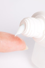 Cream  a tube with  finger at women's hands in close-up