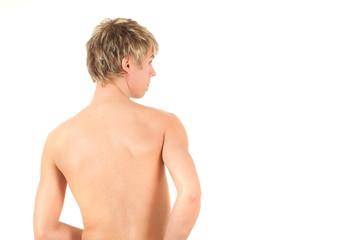 Rear view of naked boy, studio shot