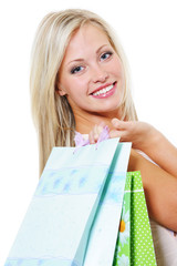 Portrait of beautiful woman with purchases