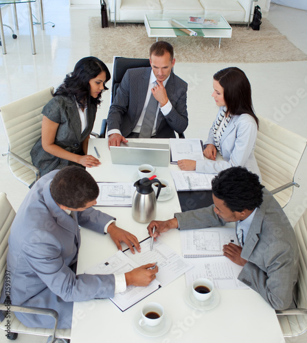 High angle of businessteam working in a meeting