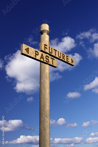 Wooden signpost for future and past