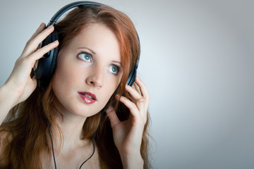 The young girl with headphones
