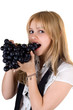 Portrait of the girl eating grapes. Isolated