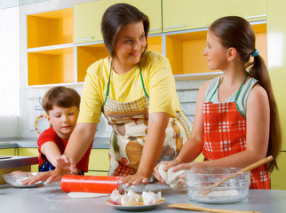 mother with children bake cake
