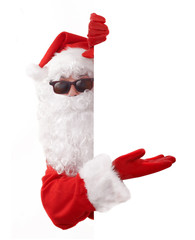 santa claus in shades holding an advertising sign