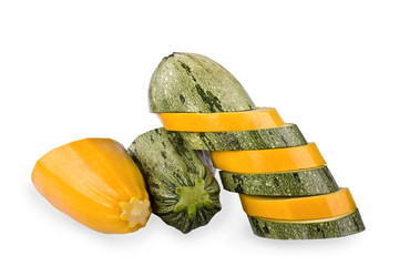 Green and yellow vegetable marrows on a white background