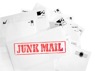 Envelope pile with junk mail rubber stamp