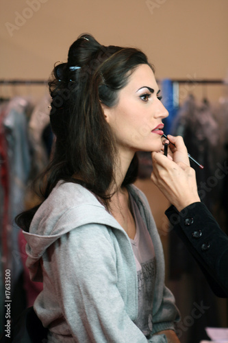 Woman having her makeup done