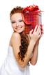 pretty girl holding present close her head