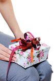 unrecognizable female person holding on her knees  present box poster
