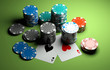 poker chips with two aces on green casino table