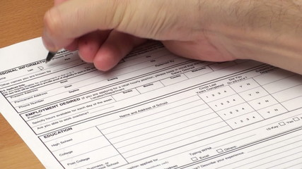Filling out application for employment - HD