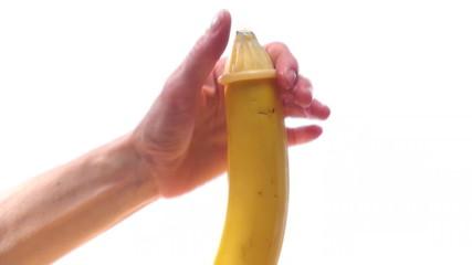 Putting condom on banana - HD