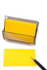 Yellow Business (blank) card on White with pen