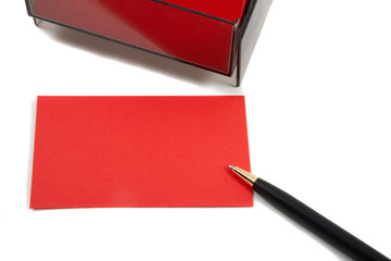 Red Business (blank) card on White with pen.