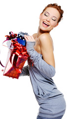 laughing  woman holding the christmas boxes