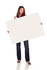 Beautiful young woman holding white board