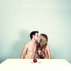 Two nude lovers with apple