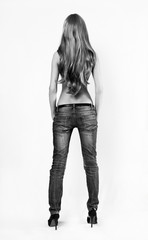 Young sensual woman in jeans
