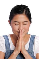 Asian girl prays