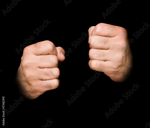 Fists isolated on black background