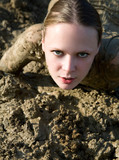 Beautiful girl struggling in the mud poster