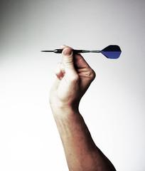 main flèchette viser réussite objectif