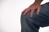 Hand Rubbing Knee poster