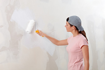 Young woman decorate her new apartment