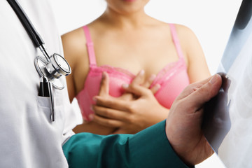 Doctor examine xray slide with woman on pink bra