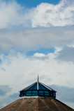 cloudscape over building spire and rooftop poster