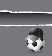 Soccer ball with hat on gray ripped advertisement
