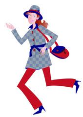 Femme rousse en manteau rouge et bleu
