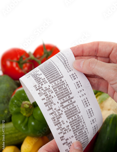 Grocery List over a bag a vegetables