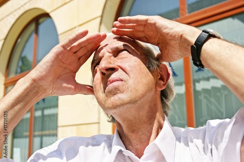 grey-haired, old man looking at the sky on a summer day
