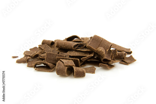 pile chocolate flakes over white background