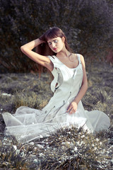 girl in white dress on the grass