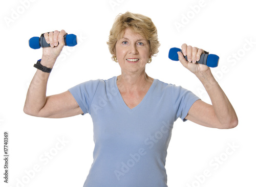 Active senior exercising with weights