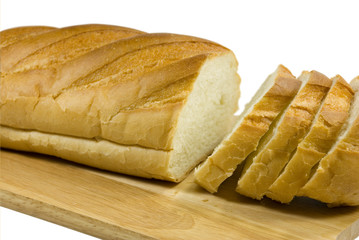 White bread lays on a chopping board